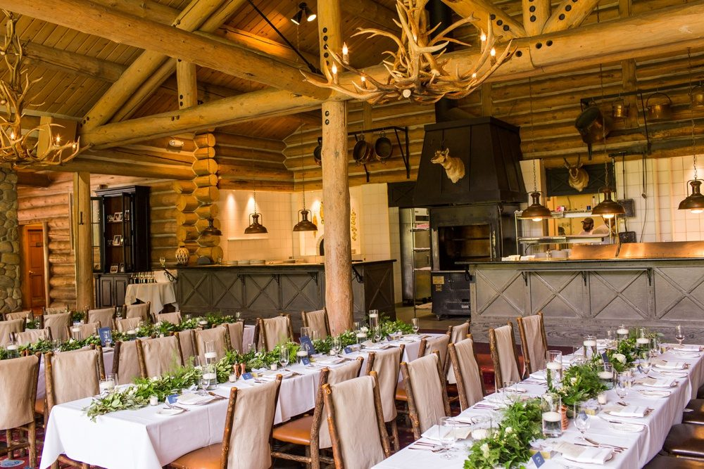 The interior of Beano's Cabin, a log cabin on the slopes of Beaver Creek Resort, decorated for a wedding reception.