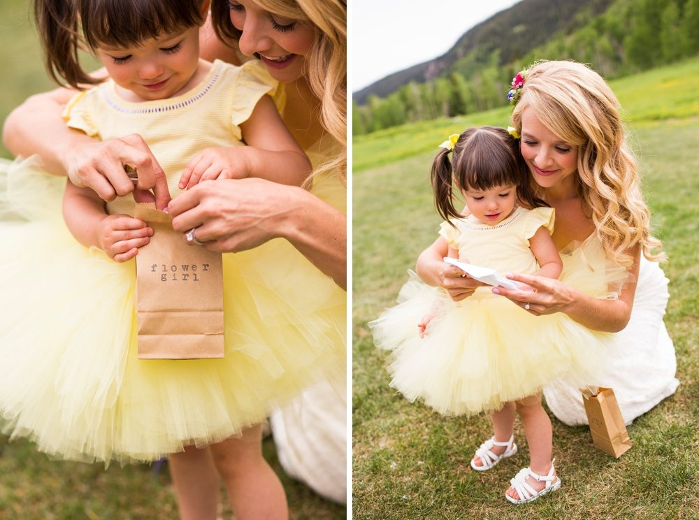A bride greets her flower girl with a gift before starting the wedding ceremony.