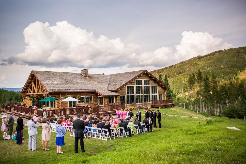 An outdoor wedding on the lawn at Beano's Cabin as seen from a distance.