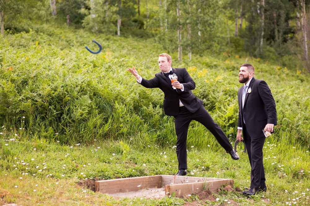 wedding guests play yard games at beano's cabin in colorado