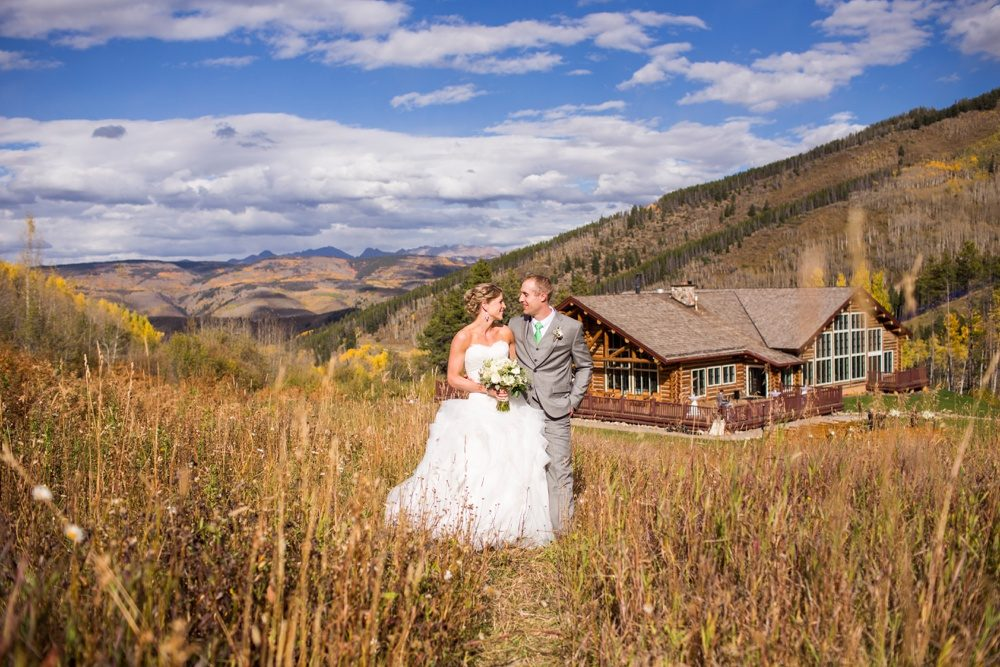 portrait of a bride and groom surrounded by the beauty of the rocky mountains with beano's cabin in the background