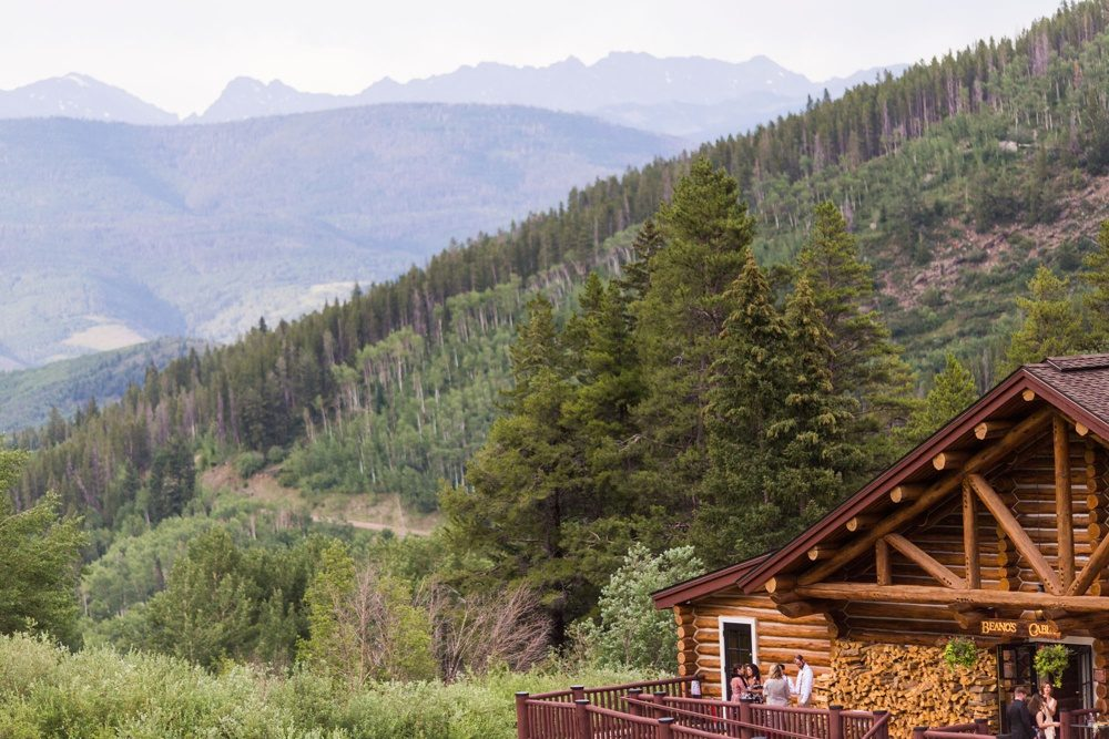 the exterior of beano's cabin as seen from the distance with the gore range in the background