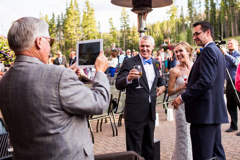 A bride and groom FaceTime their loved ones that could not attend their wedding.