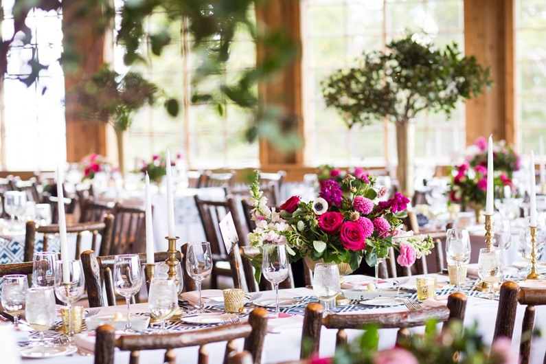 Tall and short centerpieces decorate the dining room at Ten Mile Station.