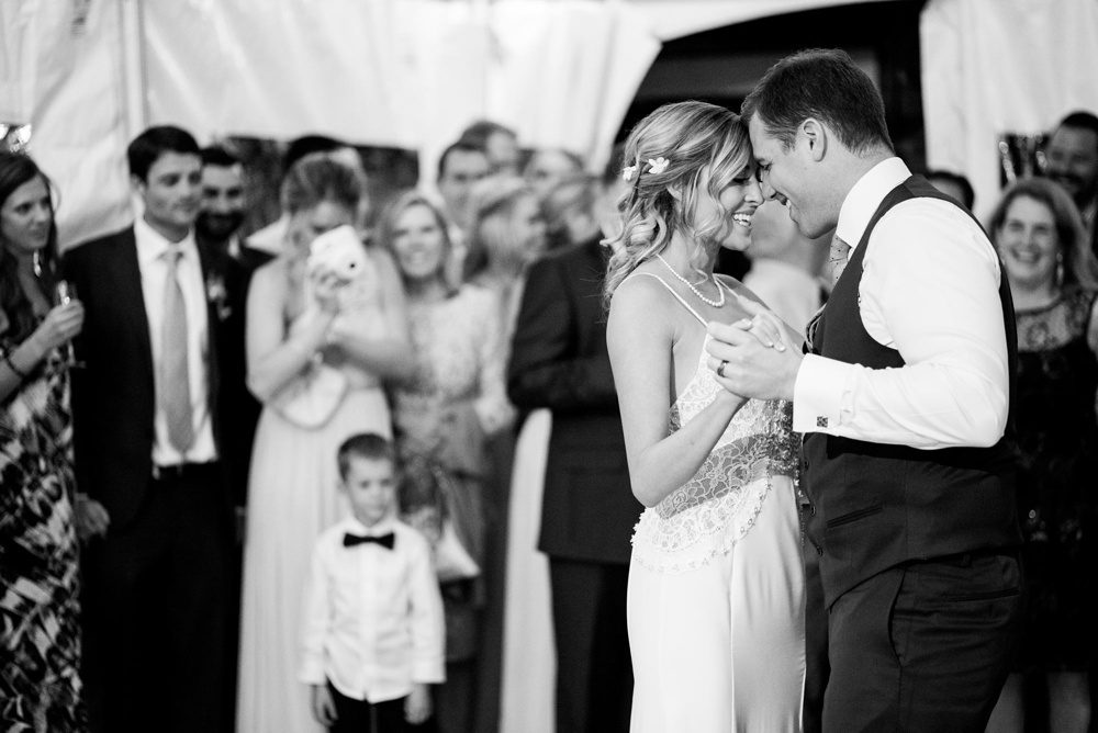 a bride and groom share their first dance as husband and wife at their colorado wedding