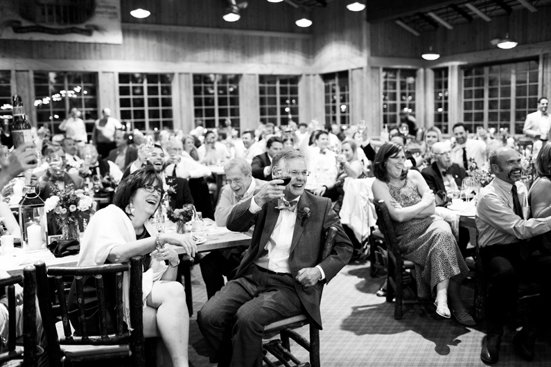 Guests raise their glasses to toast the Bride & Groom.