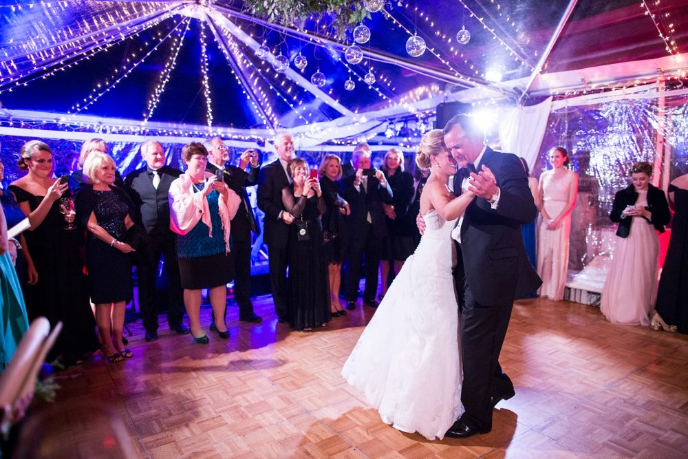 father and daughter share a dance inside a clear tent at beano's cabin in colorado