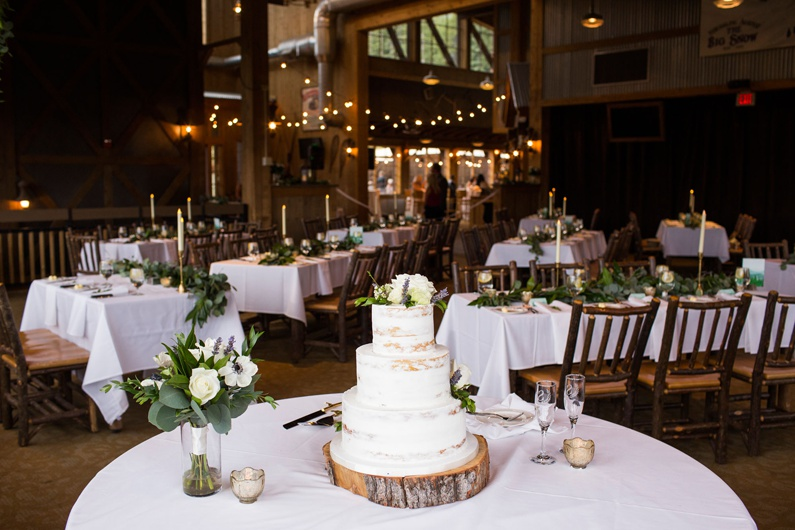 Wedding cake and decor inside the dining room at Ten Mile Station.