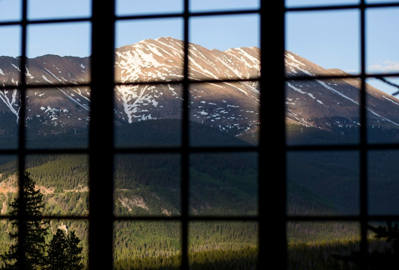 Looking thru the window of Ten Mile Station to the view of Mt Baldy.