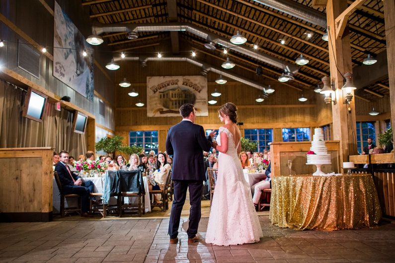 Bride and groom offer a toast at their Breckenridge wedding.
