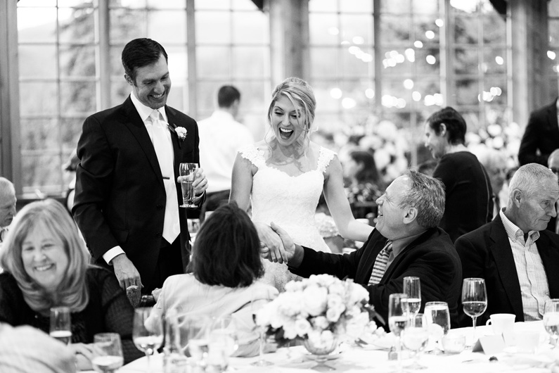 Bride and groom greet their guests at their tables.