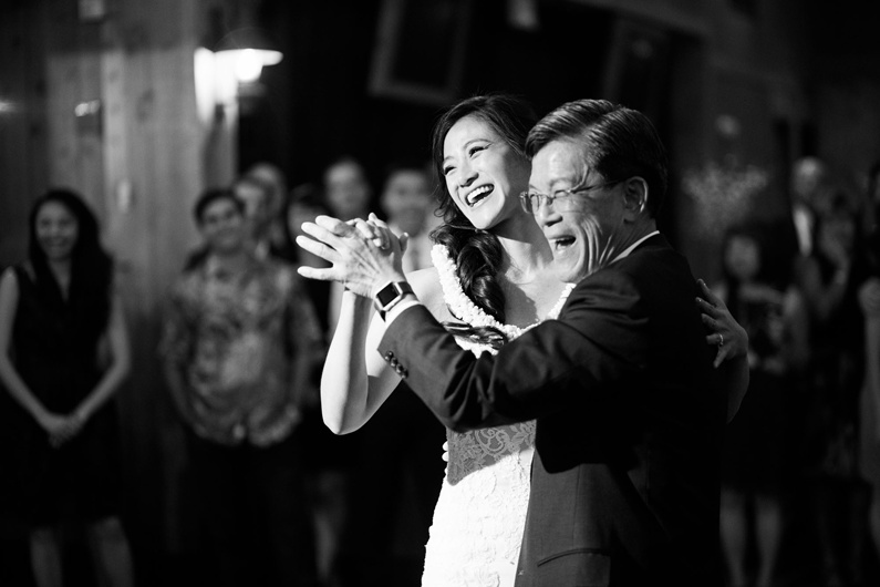 A bride and her father share a dance to kick off the wedding reception.
