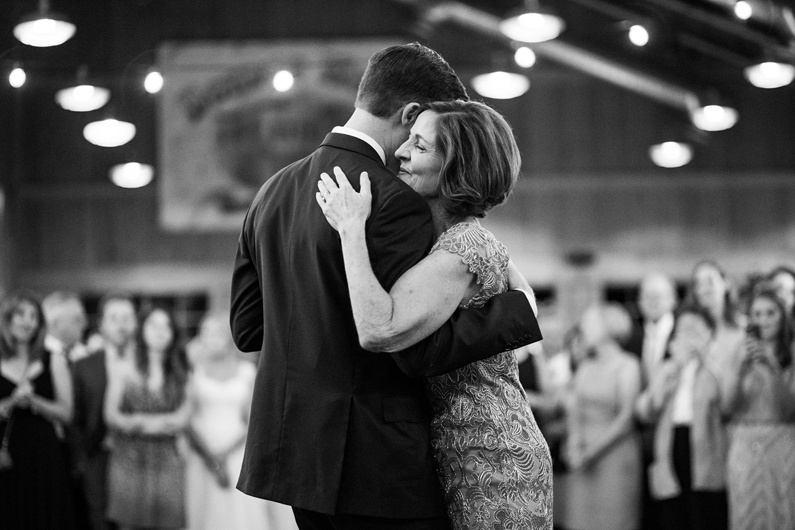 A Groom and his mother share a dance at the wedding reception.