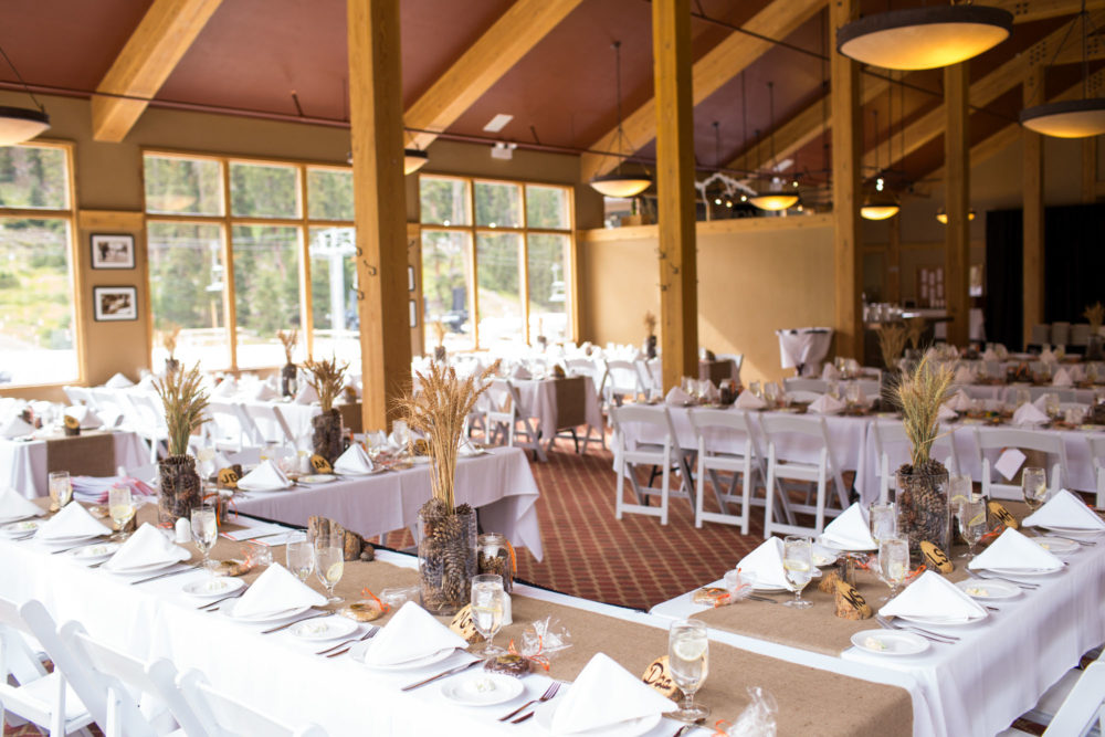 chairs and tables decorated for mountain wedding reception